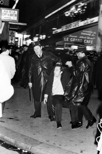 Left wing activists and communist party members are arrested by policemen, on December 17, 1966 during a demonstration in the streets of Paris and near Place of Opera against the Vietnam war and to support the Vietnamese Youth. (Photo credit should read -/AFP/Getty Images)